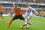 Wolverhampton Wanderers defender Matt Doherty (2) makes a tackle Derby County striker Johnny Russell (7) 0-2 during the EFL Sky Bet Championship match between Wolverhampton Wanderers and Derby County at Molineux, Wolverhampton, England on 5 November 2016. Photo by Alan Franklin.