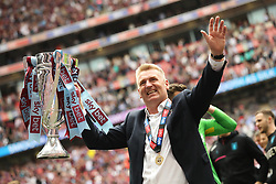 May 27, 2019 - London, England, United Kingdom - Aston Villa Manager Dean Smith lifts the play off trophy during the Sky Bet Championship Play Off Final between Aston Villa and Derby County at Wembley Stadium, London on Monday 27th May 2019. (Credit Image: © Mi News/NurPhoto via ZUMA Press)