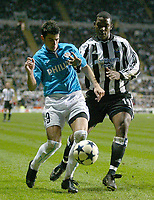 Photo. Andrew Unwin.<br /> Newcastle United v PSV Eindhoven, UEFA Cup Quarter Final Second Leg, St James' Park, Newcastle upon Tyne 14/04/2004.<br /> PSV's Mateja Kezman (l) is watched by Newcastle's Titus Bramble (r).