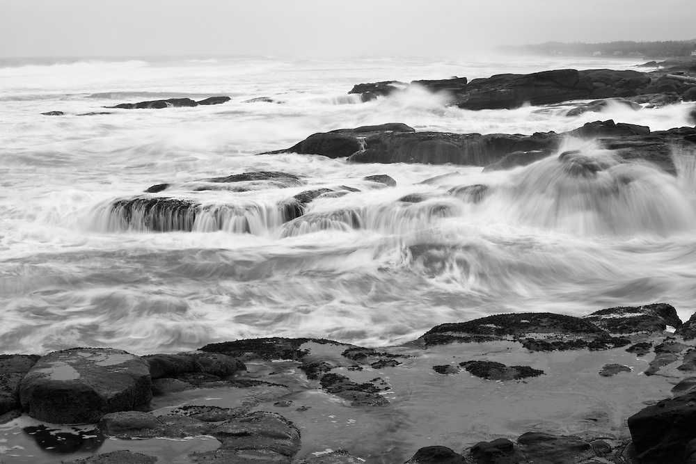 Waves violently pounding the shoreline near Yachats, Oregon during a summer storm.