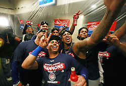 September 27, 2017 - St. Louis, MO, USA - Chicago Cubs relief pitcher Pedro Strop (46), takes a photo with Chicago Cubs right fielder Leonys Martin (24), and other teammates, while celebrating their clinching game against the St. Louis Cardinals on Wednesday, Sept., 27, 2017 at Busch Stadium in St. Louis, Mo. (Credit Image: © Nuccio Dinuzzo/TNS via ZUMA Wire)