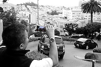 Guy doing a video of the cars on Lombard Street.