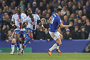 Everton midfielder Gareth Barry  catches Crystal Palace defender Pape Souare  during the Barclays Premier League match between Everton and Crystal Palace at Goodison Park, Liverpool, England on 7 December 2015. Photo by Simon Davies.