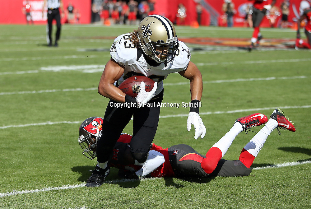 New Orleans Saints wide receiver Willie Snead (83) breaks free from a tackle attempt as he catches a late second quarter pass for a first down at the Tampa Bay Buccaneers 21 yard line during the 2015 week 14 regular season NFL football game against the Tampa Bay Buccaneers on Sunday, Dec. 13, 2015 in Tampa, Fla. The Saints won the game 24-17. (©Paul Anthony Spinelli)