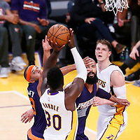 06 November 2016: Los Angeles Lakers forward Julius Randle (30) takes a jump shot over Phoenix Suns forward Jared Dudley (3) and Phoenix Suns center Tyson Chandler (4) during the LA Lakers 119-108 victory over the Phoenix Suns, at the Staples Center, Los Angeles, California, USA.