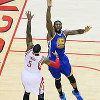 25 May 2015: Houston Rockets forward Josh Smith (5) goes for the baby hook over Golden State Warriors center Festus Ezeli (31) during the Houston Rockets 128-115 victory over the Golden State Warriors, in game 4 of the Western Conference finals, at the Toyota Center, Houston, Texas, USA.