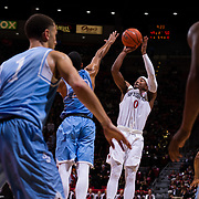 05 December 2018: San Diego State Aztecs guard Devin Watson (0) takes a contested jump shot with San Diego Toreros guard Devin Moss (20) applying pressure in the second half. The Aztecs lost to the Toreros 73-61 at Viejas Arena.