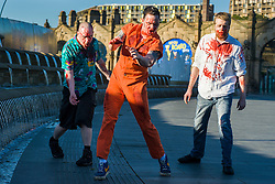 Slingshots Top Zombies Alex Noble, Noel Davies-Atack and Paul Byrne outside Sheffield Railway station on Tuesday evening ahead of the game 2.8 Hours Later which reaches the city in August <br /> <br /> 30 June 2015<br />  Image &copy; Paul David Drabble <br />  www.pauldaviddrabble.co.uk