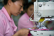 Chinese seamstresses at work making bras in the Top Form factory in Longnan, China
