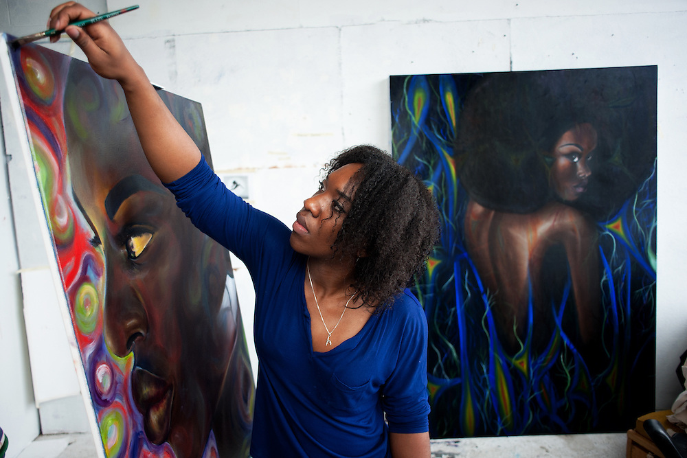 Senior painting student Tia Daniels prepares for her senior thesis show in her studio in Seignfreid Hall. Photo by: Ross Brinkerhoff.