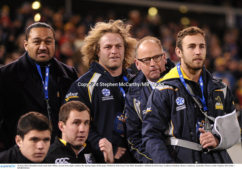 18 June 2013; Brumbies head coach Jake White, second from right, watches the closing stages of the game. British & Irish Lions Tour 2013, Brumbies v British & Irish Lions. Canberra Stadium, Bruce, Canberra, Australia. Picture credit: Stephen McCarthy / SPORTSFILE
