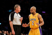 27 April 2010: Guard Derek Fisher of the Los Angeles Lakers argues a call with NBA official Bob Delaney while playing against the Oklahoma Thunder during the first half of the Lakers 111-87 victory over the Thunder during game 5 of the first round of the NBA Playoffs at the STAPLES Center in Los Angeles, CA.