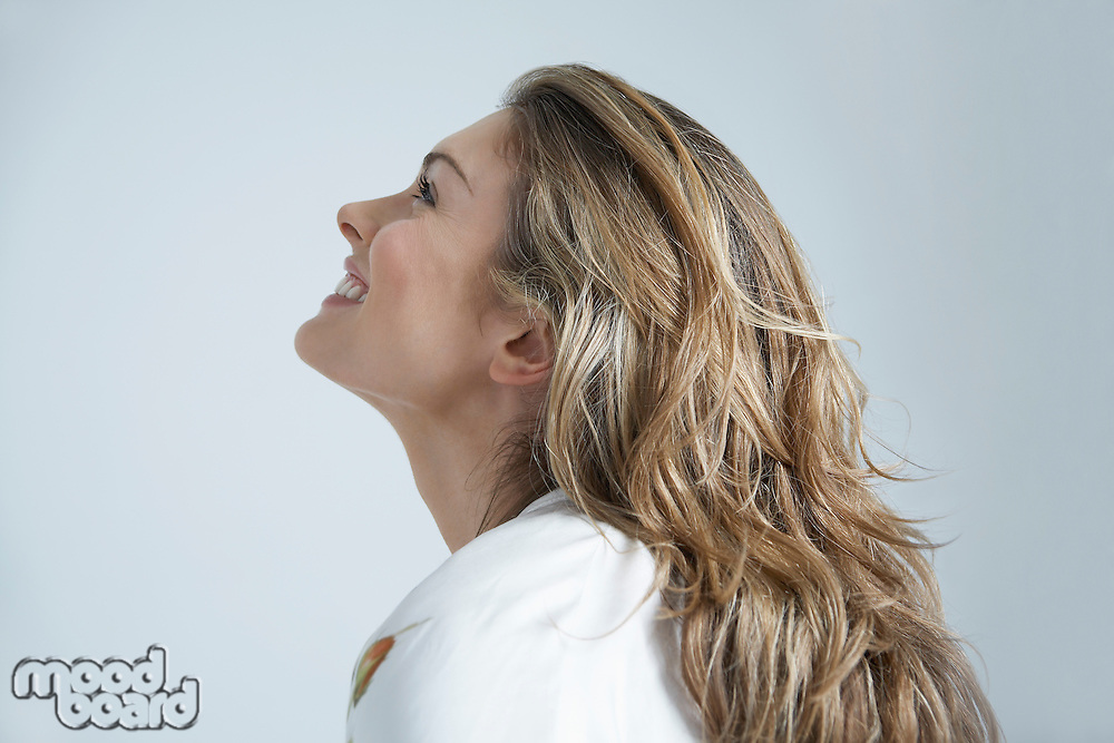 Profile of young woman smiling