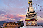 The stupa of Swayambunath at sunset, one of the oldest and most holy religious sites in Kathmandu.