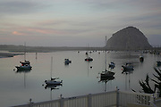 CALIFORNIA COAST - JANUARY 3:  2006 Boats are docked and the water is calm as the rock stands tall in Morro Bay during New Year's vacation driving along the California Coast on January 3, 2006 in Morro Bay, California. ©Paul Anthony Spinelli