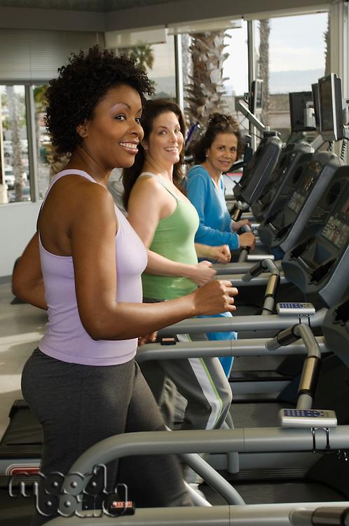 Women Exercising on Treadmills at Health Club