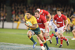 © Licensed to London News Pictures. 16/06/2012. Etihad Stadium, Melbourne Australia. Digby Ioane charges toward the try line during the 2nd Rugby Test between Australia Wallabies Vs Wales . Photo credit : Asanka Brendon Ratnayake/LNP