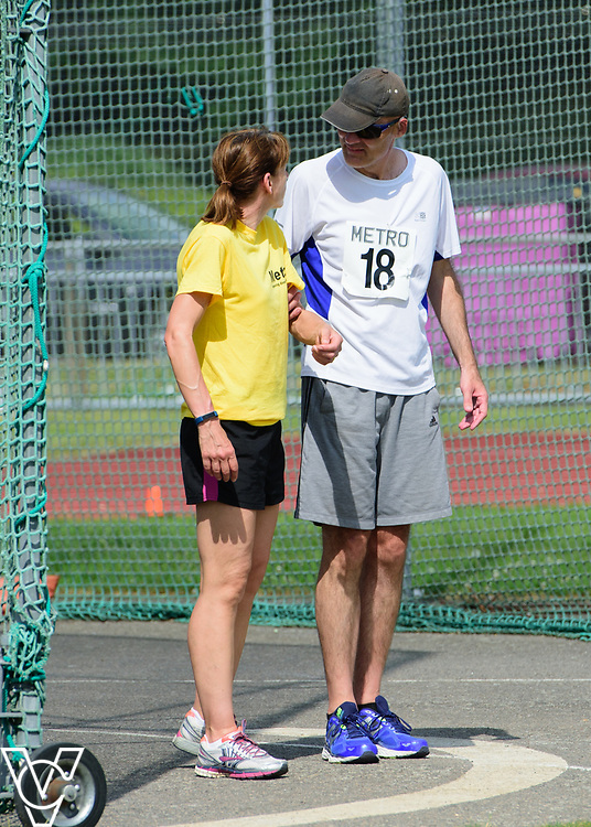 Metro Blind Sport's 2017 Athletics Open held at Mile End Stadium.  Discus.  David Beynon with volunteer<br /> <br /> Picture: Chris Vaughan Photography for Metro Blind Sport<br /> Date: June 17, 2017