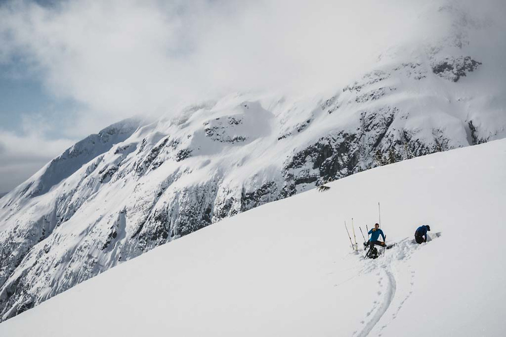 Sean Fraser and Simon Thomson playing in the snow, Howson Range, British Columbia.