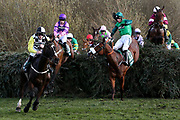 Pleasant Company leads the field over Canal Turn as Uncello Conti almost unseats Daryl Jacob (22) on the second circuit of The Randox Health Grand National on Grand National Day at at Aintree, Liverpool, United Kingdom on 14 April 2018. Picture by Craig Galloway.