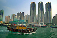 Hong Kong, China, October 2006. Floating houses, fishermen and loads of sampans in the water. The over populated city of Hong Kong is densely populated. On a daily basis millions of people cross the waters by ferry, get stuck in traffic jams. photo by Frits Meyst/Adventure4ever.com.