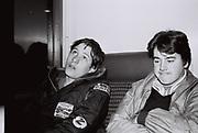 Two teenage friends on the train. London, UK, 1980s.