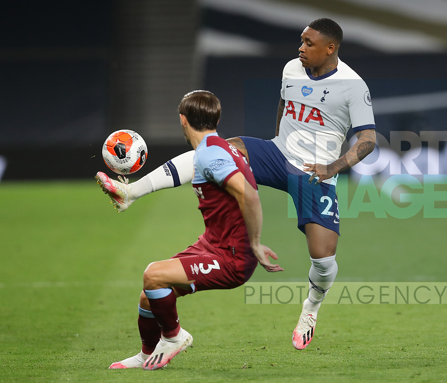 Steven Bergwijn of Tottenham controls the all in front of Aaron Cresswell of West Ham United  during the Premier League match at the Tottenham Hotspur Stadium, London. Picture date: 23rd June 2020. Picture credit should read: David Klein/Sportimage