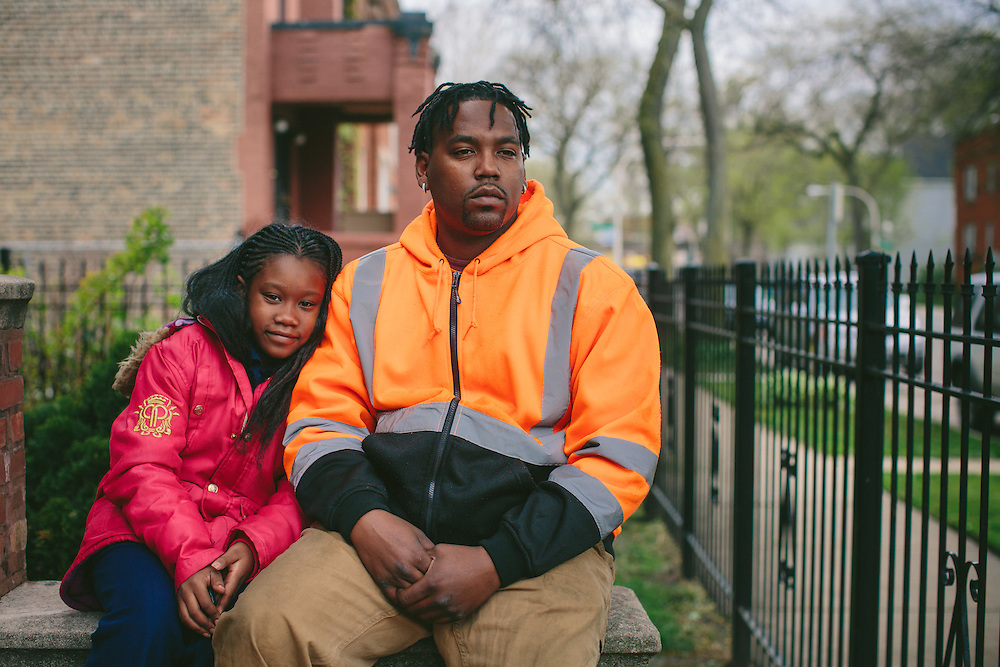 "Kareen Noble, 33, and his daughter Kamaria, 10, Englewood, South Side: ""I think the public schools are underfunded. They don't have a lot to offer. My wife is a substitute teacher, so I get this first-hand. My neighborhood is not a good environment for a child to grow up in, mainly because of the violence. I do allow my kids to go out alone, but not for very long."""