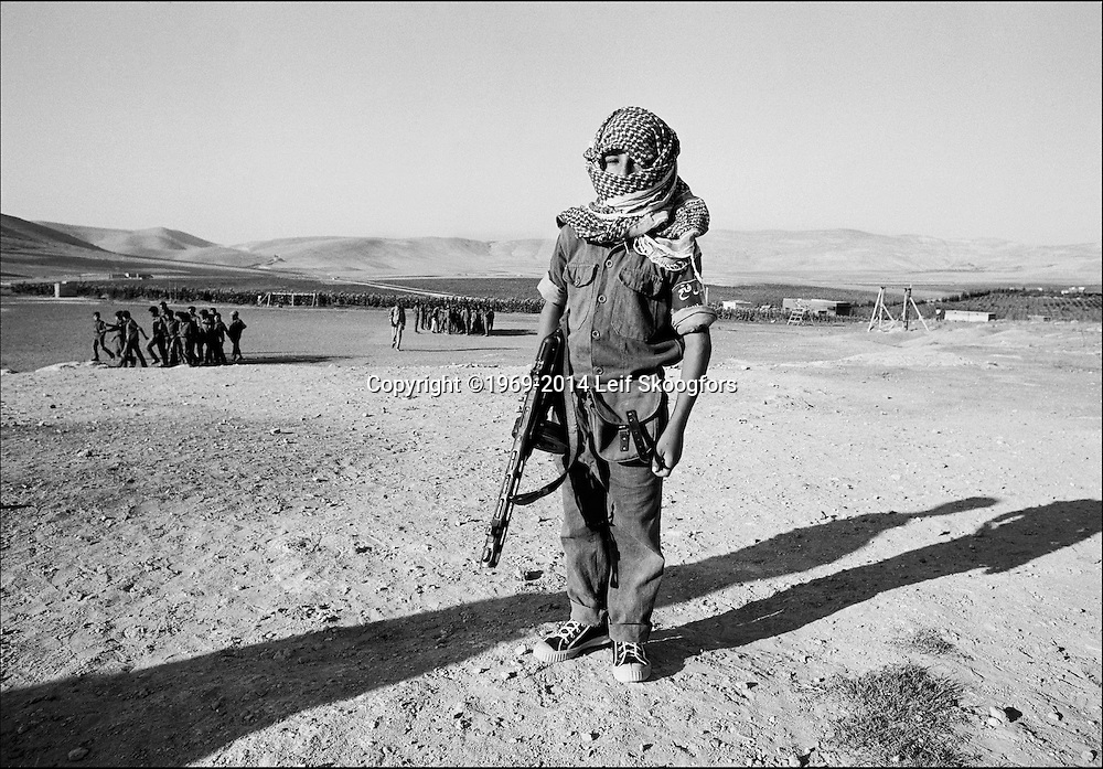 "1968 --- An 8 year old boy, known as ""Le Monstre"", is training with Al-Fatah at the Palestine Liberation Organization training camp . The Baka refugee camp, some 20 kilometers from Amman. Known as ashbal, or ""tiger cubs"". He is carrying a Chinese PPSh sub-machine gun."