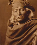 Chino, head-and-shoulders portrait of a Native American, facing front, c1903. Photograph by Edward Curtis (1868-1952).