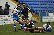 Ryan Fieldhouse (R) of Barrow Raiders tackles Greg Worthington of Toronto Wolfpack during the Betfred Championship match at Craven Park, Barrow-in-Furness<br /> Picture by Stephen Gaunt/Focus Images Ltd +447904 833202<br /> 11/02/2018r