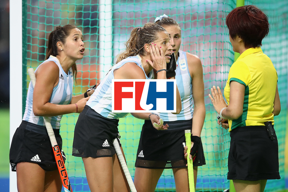 RIO DE JANEIRO, BRAZIL - AUGUST 10:  Rocio Sanchez, Delfina Merino and Florencia Habif of Argentina make their point to the umpire during the women's pool B match between Great Britain and Argentina on Day 5 of the Rio 2016 Olympic Games at the Olympic Hockey Centre on August 10, 2016 in Rio de Janeiro, Brazil.  (Photo by Mark Kolbe/Getty Images)
