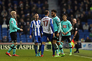 Derby County defender Cyrus Christie (2) and Brighton & Hove Albion centre forward Glenn Murray (17) square up during the EFL Sky Bet Championship match between Brighton and Hove Albion and Derby County at the American Express Community Stadium, Brighton and Hove, England on 10 March 2017.