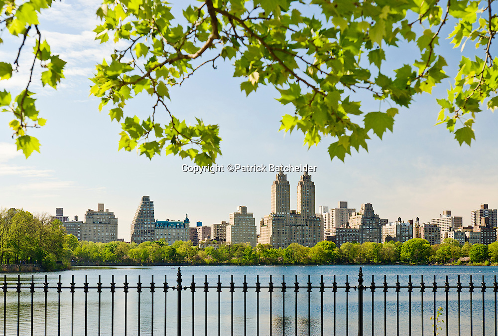 The Jacqeuline Kennedy Onassis Reservoir, Central Park, New York City in spring season with the El Dorado Apartments on Central Park West in the background.