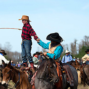 Justin Mickelsen, 13, demonstrates his whip cracking ability atop his horse at the end of the Great Florida Cattle Drive '16. &quot;Awesome.&quot; said Mickelsen of Mobile, Alabama about his six day trip into the Florida wilderness.   <br />