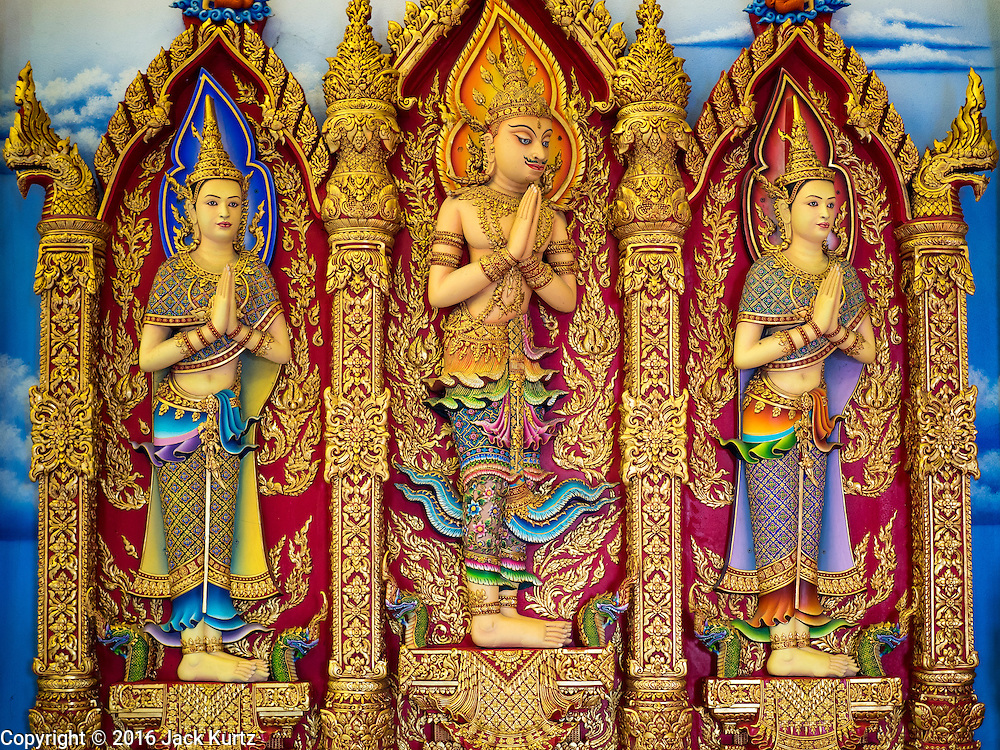 30 JANUARY 2016 - NONTHABURI, NONTHABURI, THAILAND: Statues on the wall at Wat Bua Khwan, a large Buddhist temple in Nonthaburi, north of Bangkok, Thailand.        PHOTO BY JACK KURTZ