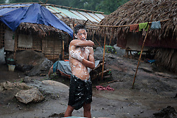 A man take a shower in Woi Chyai Internal Displacement People (IDP) refugee camp near to Laiza village close to the China border, Myanmar on July 23, 2012. According to KIO sources around 50000 Kachin people live as refugees in those camps.