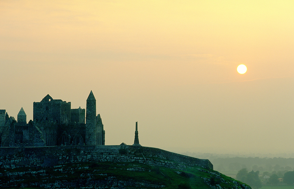 The Rock of Cashel, County Tipperary, Ireland. Sunset behind the round tower and mediaeval monastery.
