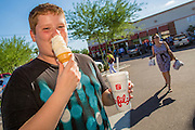 01 AUGUST 2012 - CHANDLER, AZ:  TIM EASTIN, 13, eats an ice cream cone after a meal of chicken nuggets at Chick-fil-A Wednesday. Thousands of people stood in line for up to an hour at the Chick-fil-A in Chandler, AZ, a suburb of Phoenix Wednesday after MIKE HUCKABEE, the former governor of Arkansas and Fox News host, called for a national ''Chick-fil-A Appreciation Day,'' a day on which he encouraged people to patronize the fast food chain, this after DAN CATHY, President and CEO of Chick-fil-A, who is a fundamentalist Christian, made public his views against same sex marriage, causing an outcry from political leaders and Gay rights advocates.   PHOTO BY JACK KURTZ