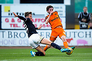 Dundee defender Jack Hendry (#22) slides in to prevent the cross from Dundee United midfielder Sam Stanton (#12) during the Betfred Scottish Cup match between Dundee and Dundee United at Dens Park, Dundee, Scotland on 9 August 2017. Photo by Craig Doyle.