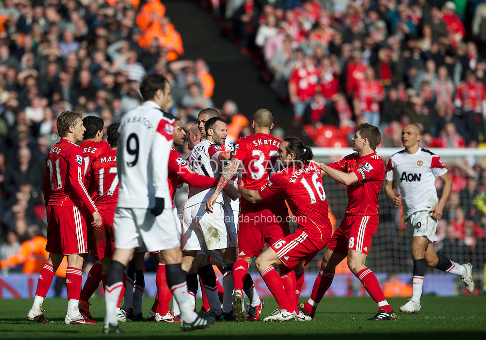 LIVERPOOL, ENGLAND - Sunday, March 6, 2011: Liverpool and Manchester United players clash after United's Rafael Da Silva dived in two-footed with a horrific challenge on Lucas Leiva during the Premiership match at Anfield. Pictured: Lucas Leiva, Ryan Giggs, Martin Skrtel, Sotirios Kyrgiakos, captain Steven Gerrard MBE. (Photo by David Rawcliffe/Propaganda)