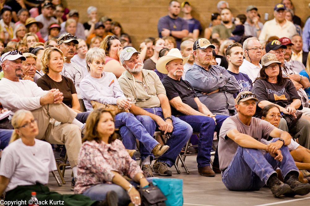 """03 JUNE 2011 - SPRINGERVILLE, AZ: People at the community meeting at Round Valley Middle School in Eager. High winds and temperatures have continued to complicate firefighters' efforts to get the Wallow fire under control. The  mandatory evacuation order for Alpine was extended to Nutrioso, about 10 miles north of Alpine and early Friday morning fire was reported on the south side of Nutrioso. The fire grew to more than 106,000 acres early Friday with zero containment. A """"Type I"""" incident command team has been called in to manage the fire.  PHOTO BY JACK KURTZ"""