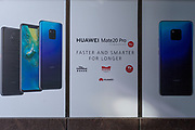 An ad for the Huawei Mate20 Pro phone outside an O2 retailer in the City of London, on 22nd January 2019, in London England.
