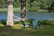 armchairs and hammock in shade by water on Shelter Island