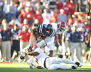 Ole Miss' Jamal Mosley (17) is tackled by Alabama linebacker Nico Johnson (35) and Alabama linebacker Dont'a Hightower (30) at Vaught-Hemingway Stadium in Oxford, Miss. on Saturday, October 14, 2011. Alabama won 52-7.