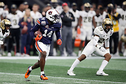 Auburn Tigers quarterback Malik Willis (14) returns a punt during the 2018 Chick-fil-A Peach Bowl NCAA football game against the UCF Knights on Monday, January 1, 2018 in Atlanta. (Jason Parkhurst / Abell Images for the Chick-fil-A Peach Bowl)