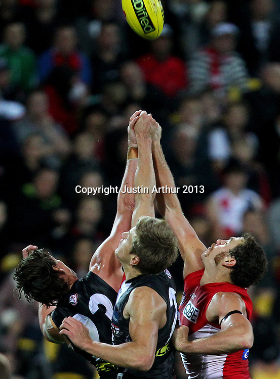 Players compete for the ball during the 2013 AFL season. St Kilda Saints v Sydney Swans, Westpac Stadium, Wellington, New Zealand on Thursday 25 April 2013. Photo: Justin Arthur / www.photosport.co.nz