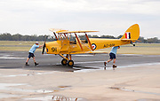 A de Havilland DH 82A Tiger Moth, formerly of the Royal Australian Air Force on display at the Temora Aviation Museum, on a rainy day.