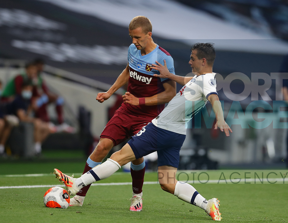 Tomas Soucek of West Ham United tackled by Giovani Lo Celso of Tottenham during the Premier League match at the Tottenham Hotspur Stadium, London. Picture date: 23rd June 2020. Picture credit should read: David Klein/Sportimage