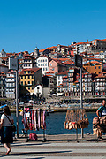 Stalls selling handicraft in an open air market on the banks of the Douro River in Vila Nova de Gaia, Porto, Portugal